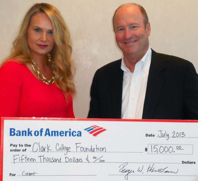 Roger Hinshaw, Bank of America's president in Oregon and Southwest Washington, and Monique Barton, senior VP of corporate social responsibility, display the gift for Clark College's Career and Volunteer Service-Learning program.