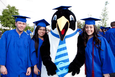 Clark's penguin mascot Oswald with members of the class of 2012