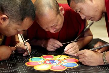 Monks working on a sand mandala