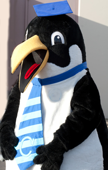 Clark's penguin mascot Oswald at commencement