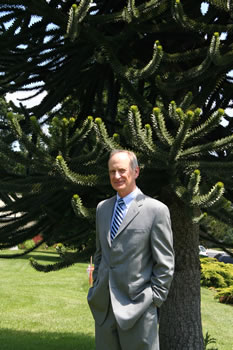 Clark alum Denis Hayes next to the