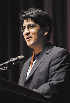 Sherman Alexie speaking at a podium