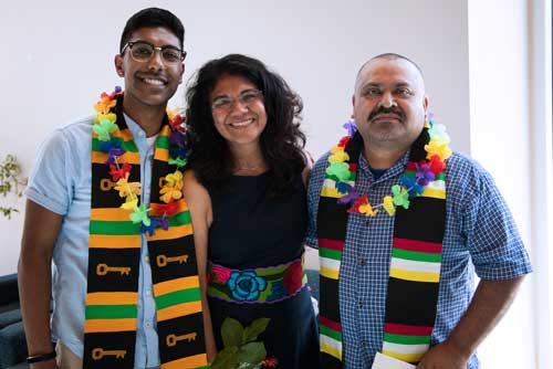 Graduates with a diversity center employee and mentor.