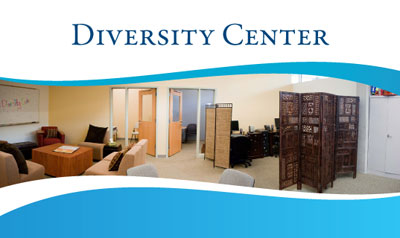 Photo of Office of Diversity and Equity showing desk area behind a carved wooden divider and bookshelves.