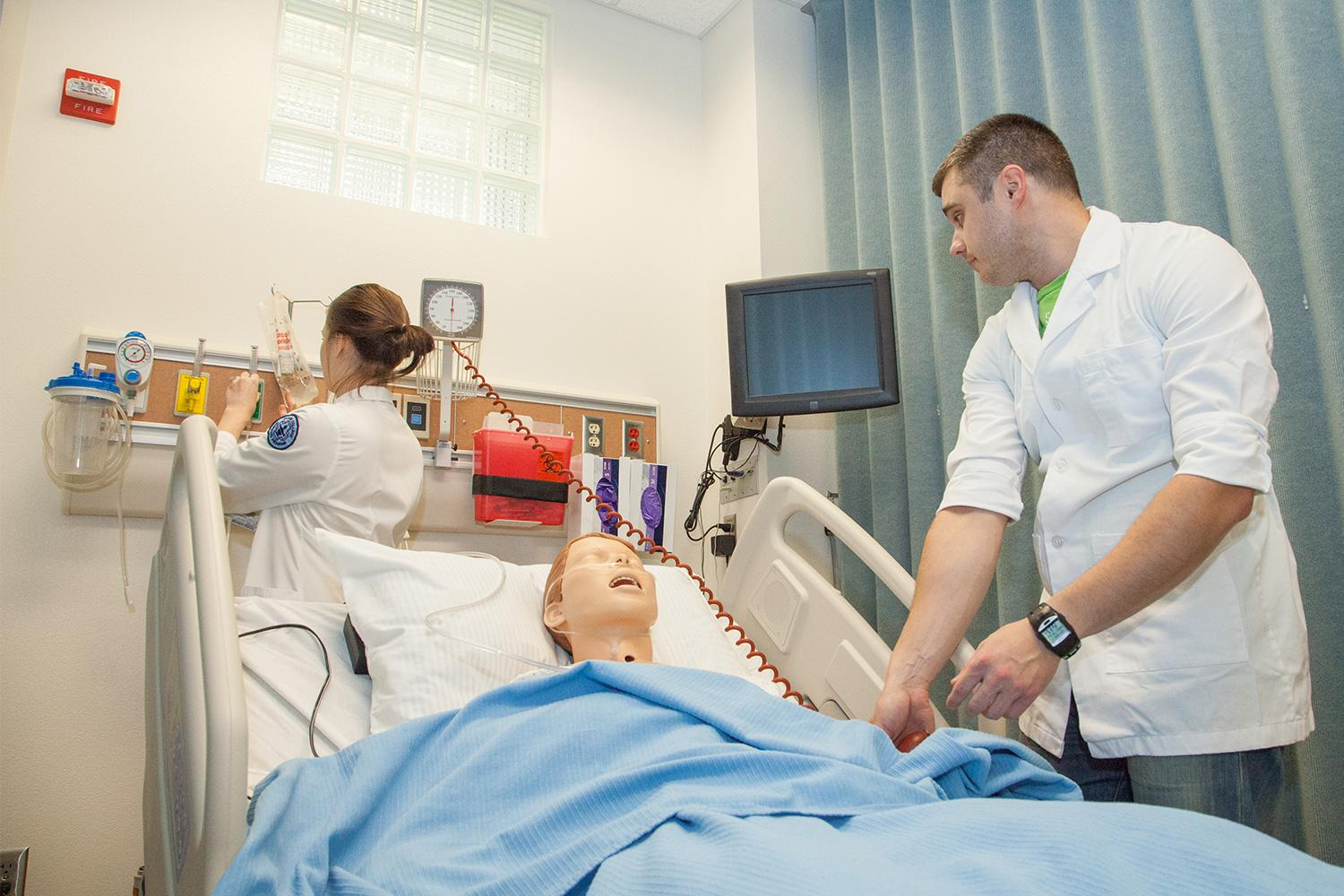 Two nursing students in simulation lab