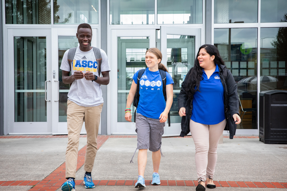 Three students walking out of Gaiser Hall
