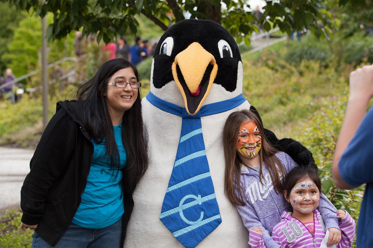 Visitors to the Latino Celebration poses with Oswald