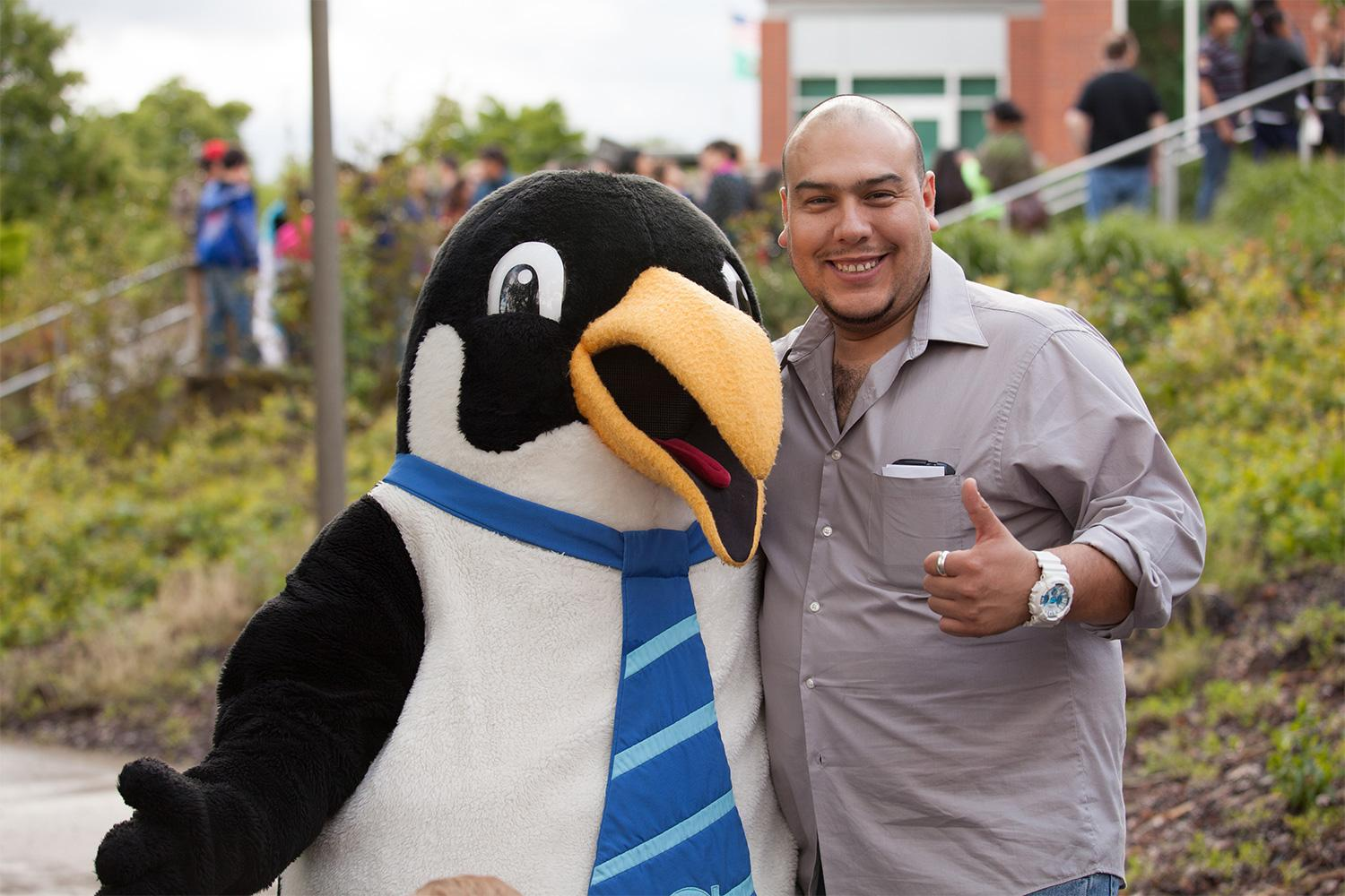 Visitor to the Latino Celebration poses with Oswald