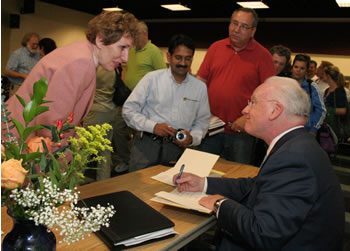 Following his keynote lecture, Clarke met audience members and signed books.