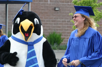 Clark College mascot Oswald salutes the graduating class of 2006.