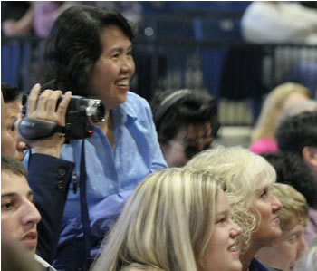 Families videotape the commencement ceremony