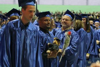 Graduates receive flowers