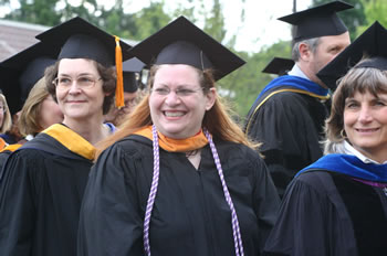 Clark College faculty members smile at graduates as they enter the Clark College Amphitheater for Commencement 2006.