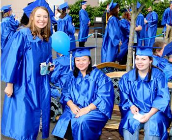 Graduates smile