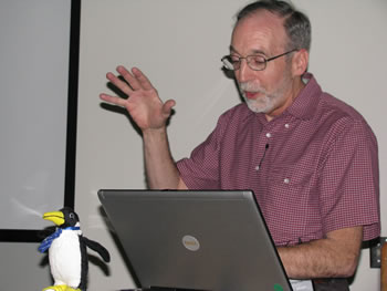 Professor Dick Shamrell lectures as Oswald listens