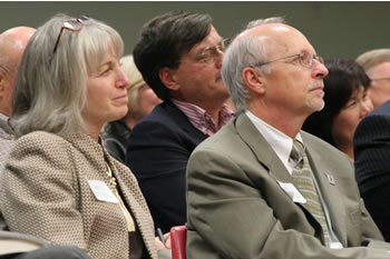 Clark College Trustees Addison Jacobs and John White listen intently to David Gergen's keynote address.