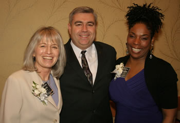 Clark College President Bob Knight congratulates two of the 2009 Women of Achievement, both of whom have ties to the college: Addison Jacobs, director of public affairs for the Port of Vancouver and member of the Clark College Board of Trustees, and Debra Jenkins, professor of early childhood education and psychology at Clark.