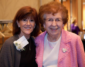 Woman of Achievement Donna Bleth (left) is congratulated by former State Rep. Val Ogden