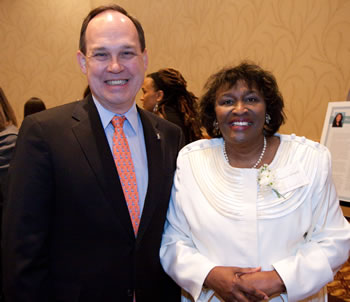 Clark College Board of Trustees Vice Chair Jack Burkman congratulations 2010 Woman of Achievement Rev. Marva Edwards.