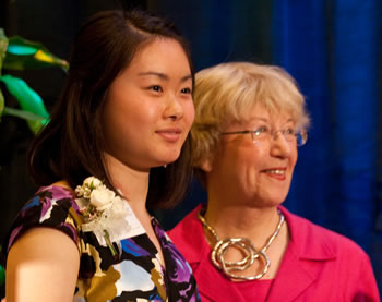 Young Women of Achievement Jing Xue (left) received a $1,500 scholarship from Clark College faculty emeritus Donna Roberge. Roberge established the first Young Woman of Achievement scholarship.