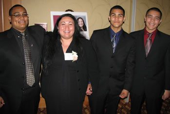 Former Clark College staff member Elizabeth Asahi Sato is joined by her sons at the 2008 Women of Achievement celebration.