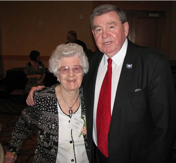 Vancouver Mayor Royce Pollard congratulates Jean Lacey for being named a Woman of Achievement at the young age of 94.