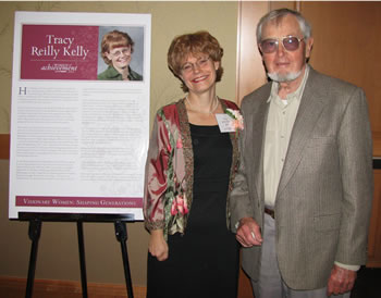 Tracy Reilly Kelly, program manager for Mature Learning and Continuing Education, receives congratulations for being named a 2008 Woman of Achievement.