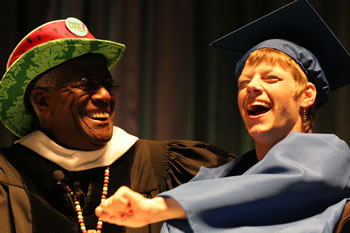 Wally Amos congratulates graduate Tiffani Evans