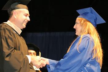 Clark College President Bob Knight congratulates a 2007 graduate