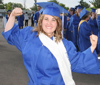 A graduate flexes the power of the Penguin Nation!