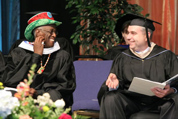 Wally Amos and President Bob Knight share a light moment during the 2007 commencement ceremony.